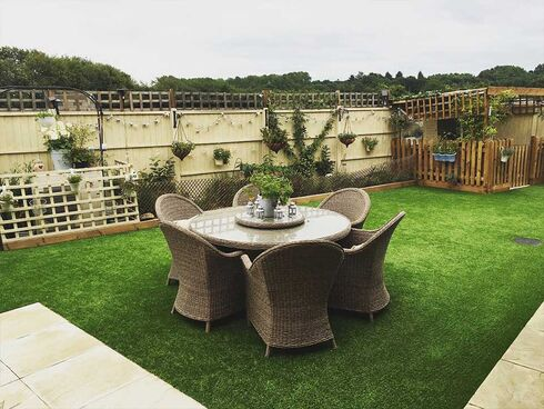 Wicker patio set on artificial grass