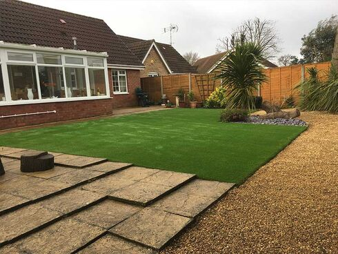Artificial grass, paving slabs and gravel