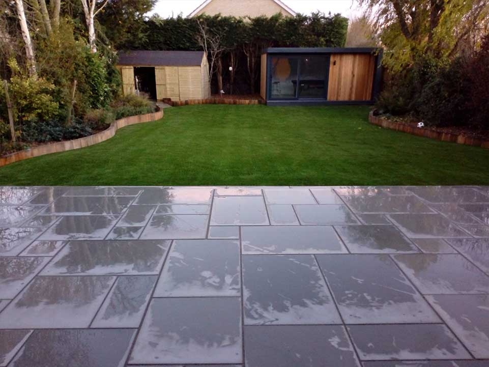 Artificial grass and paving slabs