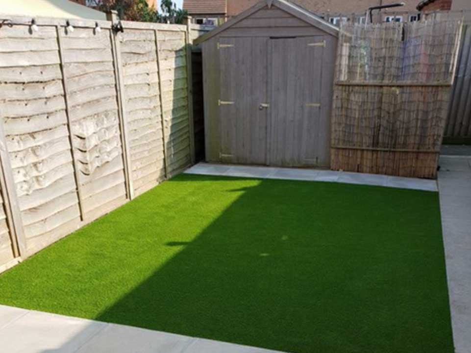 Artificial grass, paving slabs, and garden shed