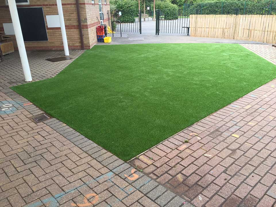 Family home with artificial grass and block paving