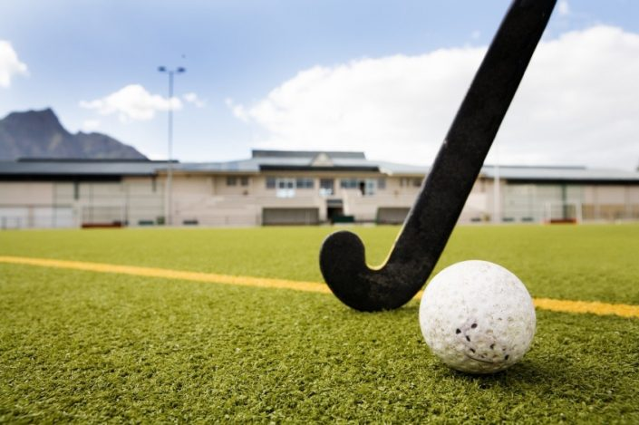 hockey pitch grass, stick and ball